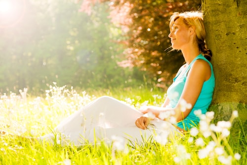Tranquil woman in sunlight